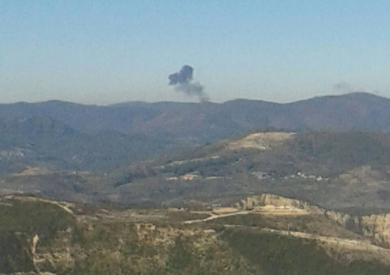 Some rises over a mountainous area in northern Syria after a war plane was shot down by Turkish fighter jets near the Turkish-Syrian border