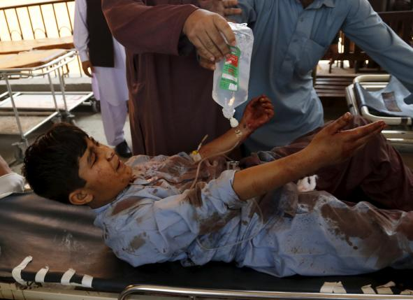 A boy injured during a suicide attack in Shabqadar is transported on a strecher at Lady Reading hospital in Peshawar