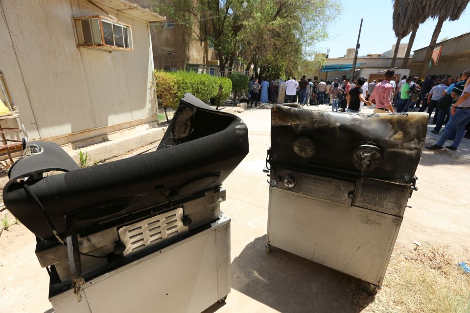 Burnt incubators stand outside Yarmuk ho