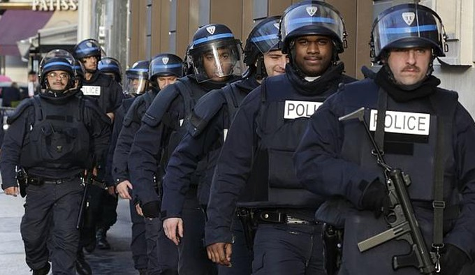 "French riot police patrol in central Paris as part of the highest level of ""Vigipirate"" security plan after a shooting at the Paris offices of Charlie Hebdo"