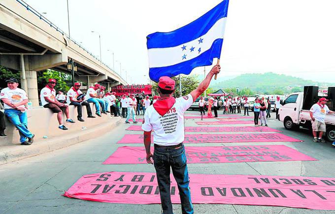 Hondureños marcharán por reivindicación de sus derechos laborales
